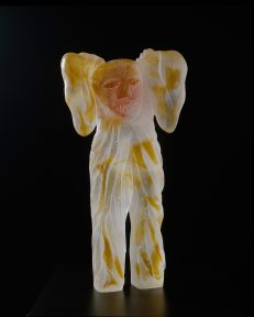 Yellow and white glass sculpture of a figure with wings