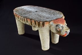 Glass sculpture of a jaguar shaped like a pre-Columbian metate