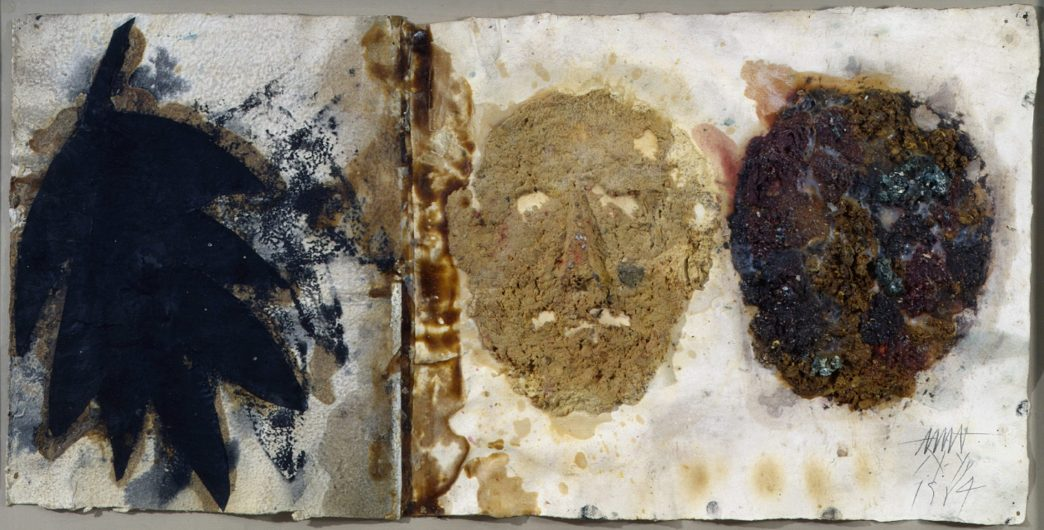 Wax and acrylic artwork showing three abstract faces, black, brown, and beige, on a white background