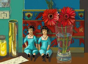 Two identical dolls sitting on a counter next to a glass containing two red zinnias.