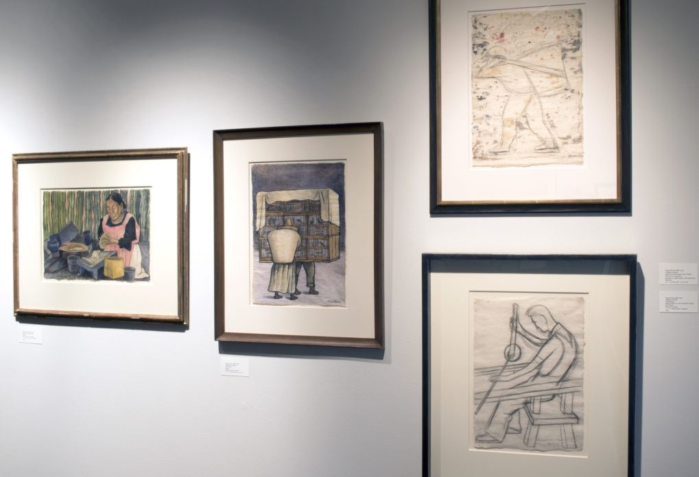Installation shot of four drawings hanging on a wall