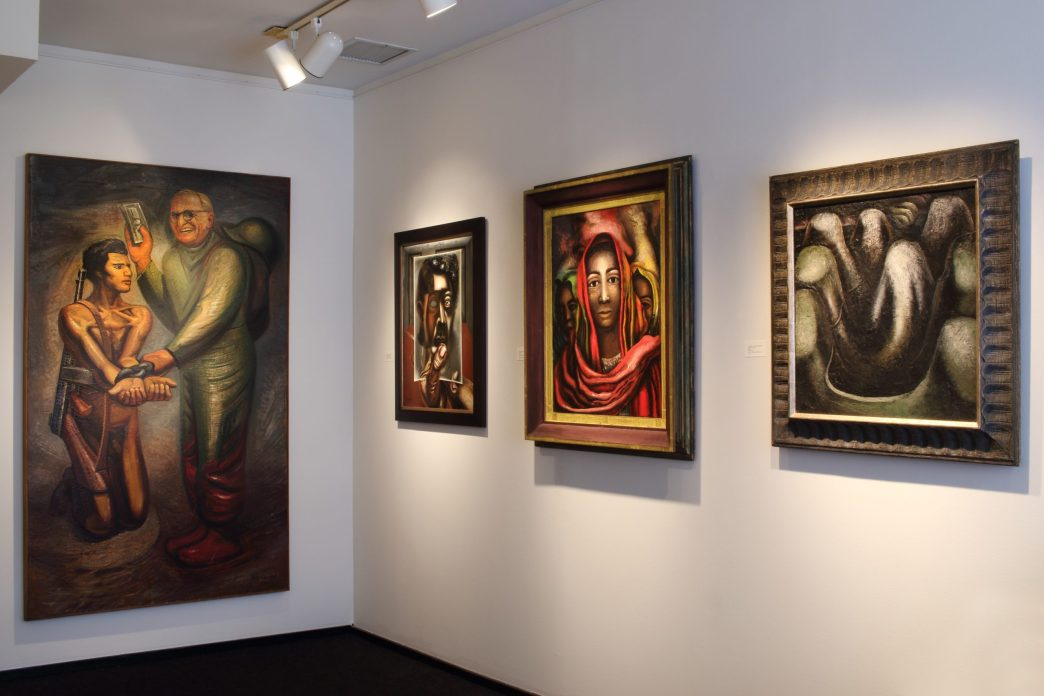 Installation shot of four paintings by David Alfaro Siqueiros