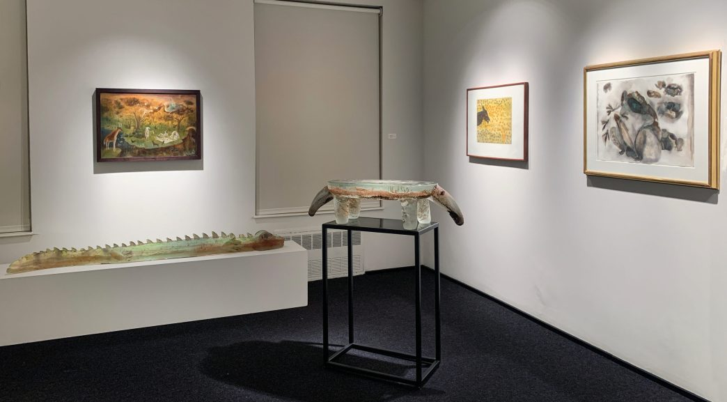 Installation shot of two glass sculptures and three paintings in the front gallery