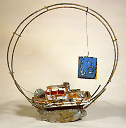 Mixed media sculpture of a boat on a rock encircled with metal hoops