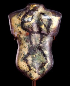 Gold and purple glass sculpture of a torso
