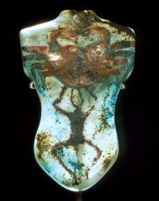 Blue glass sculpture of a torso with a crab engraved on the chest