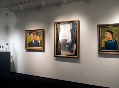 Installation show of three paintings in the show The Legacy of Paris in Latin American Art