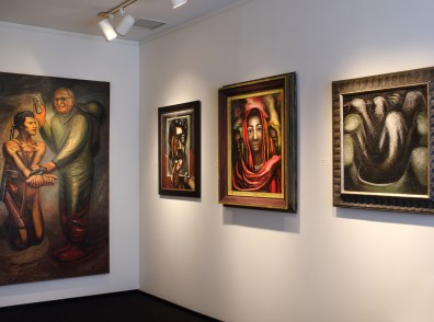 Installation shot of the back gallery with four paintings by David Alfaro Siqueiros