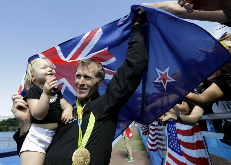 Mahe Drysdale, of New Zealand, holds his daughter, Bronte Drysdale, after winning gold in the men's rowing single sculls final during the 2016 Summer Olympics in Rio de Janeiro, Brazil, Saturday, Aug. 13, 2016. (AP Photo/Luca Bruno)