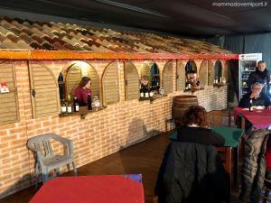 Calici e Sapori al tendone riscaldato del Borgo di Babbo Natale a Ripattoni