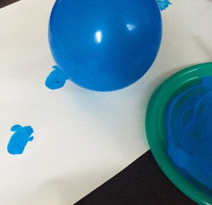 Crafting with balloon making homemade wrapping paper.