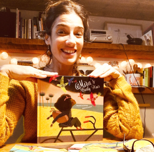Illustrator Rebeca Luciani with her book Mira's Curly Hair