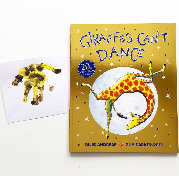 Giraffes Can't Dance book cover shot with handprint craft of a giraffe. Mammafilz.com