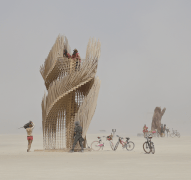 Tangential Dreams at Burning Man 2016 - Day View witth Climber and Bear - Source: https://lostcoastoutpost.com ©Mamou-Mani