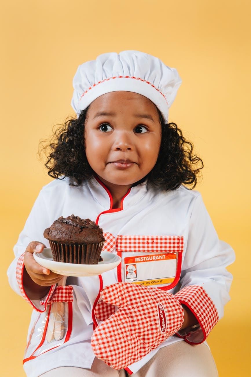 cute black girl in chef costume