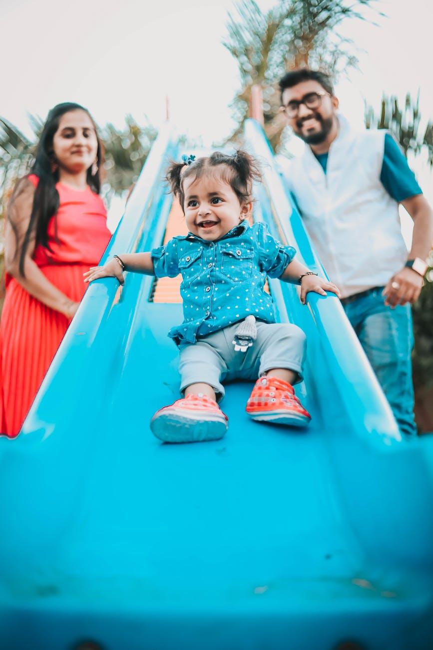 girl playing on slide