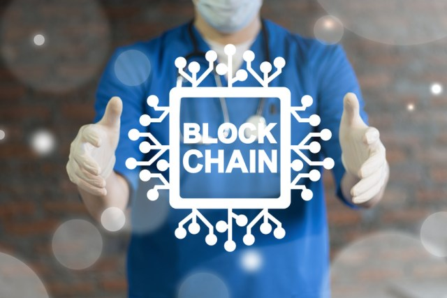 Blockchain Medicine Information Technology. Doctor using virtual interface offers semiconductor (circuit board) blockchain text icon. Block Chain Health Care concept.