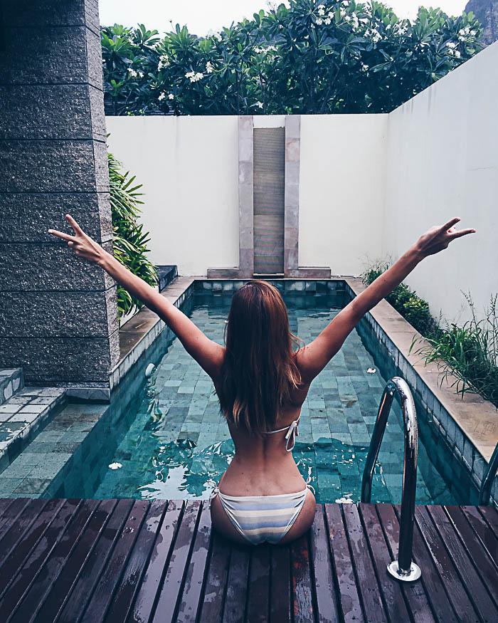 girl stretching pool villa bhu nga thani