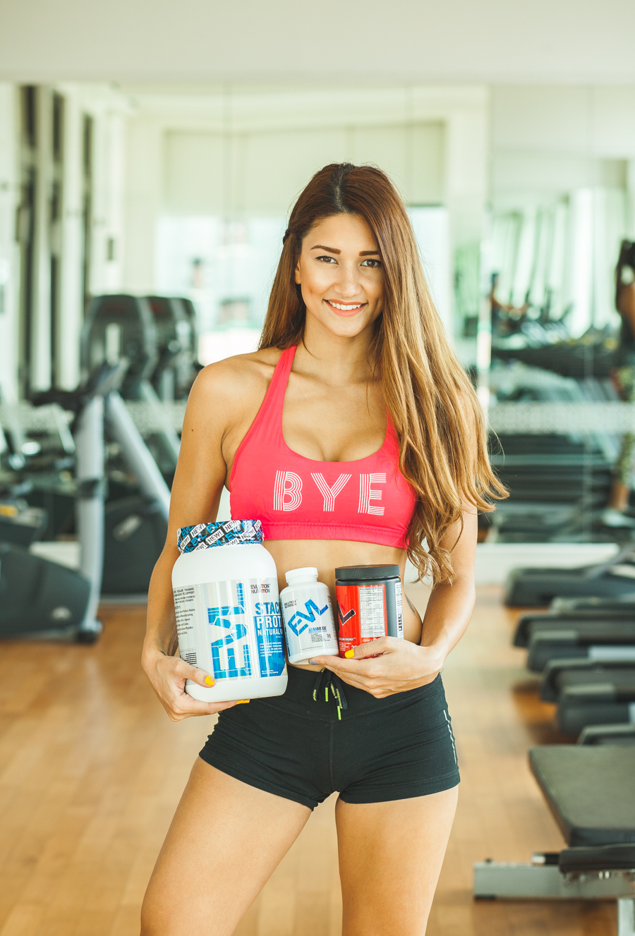 girl holding evlution fitness products in bangkok