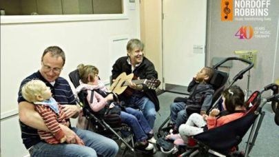 55887088-iron-maiden-frontman-bruce-dickinson-visits-londons-music-therapy-center-image