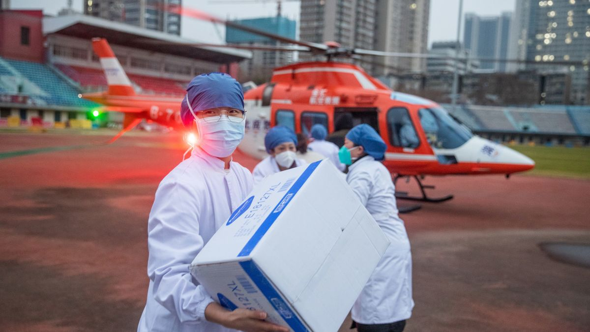 Chinese doctors delivering medical supplies with helicopter.