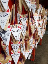 Kitsune cards tied around the shrines, made by visitors