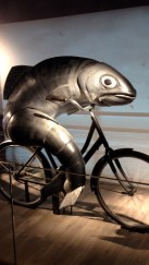 Strange/creepy guinness add with a fish riding a bike