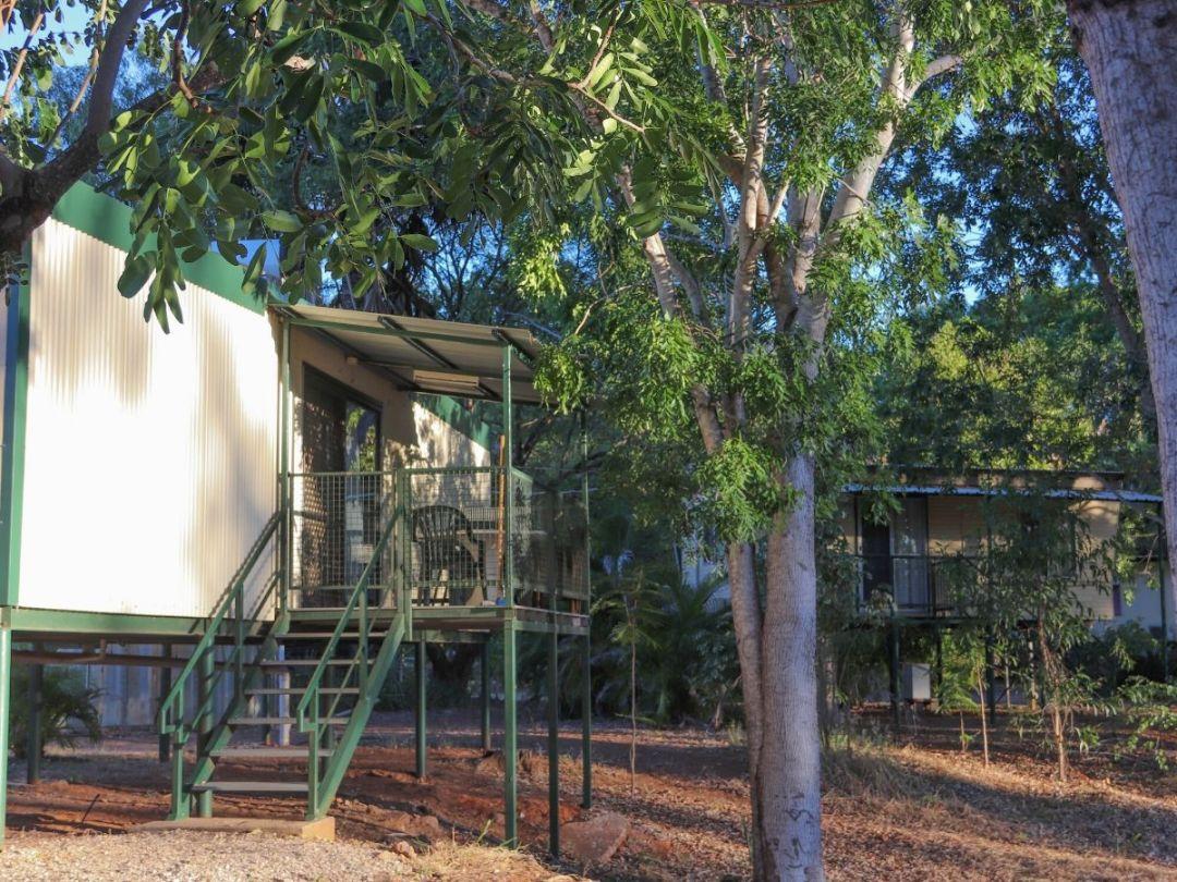 Elevated cabins with verandas at Manbulloo Homestead Caravan Park