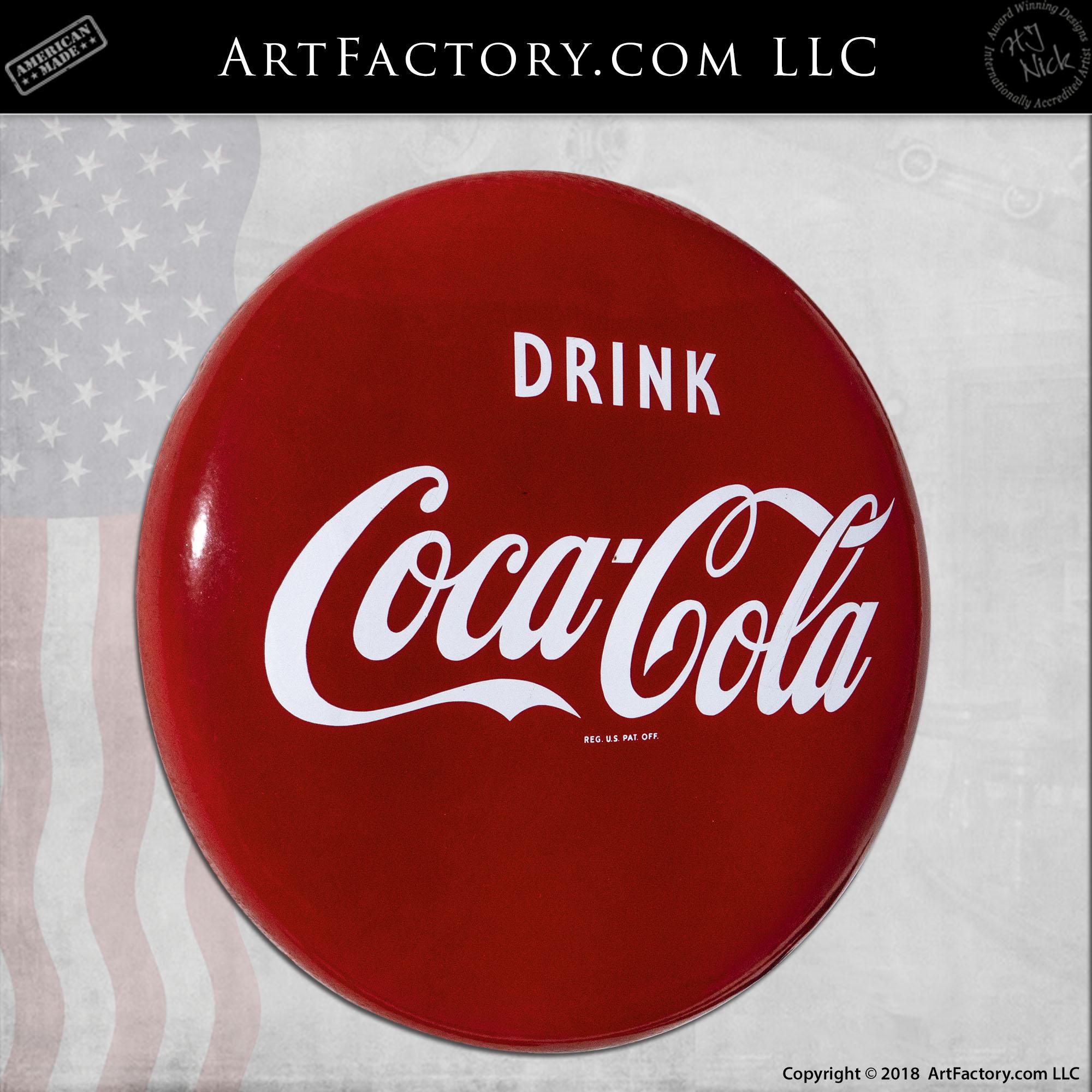 Coca-Cola button sign