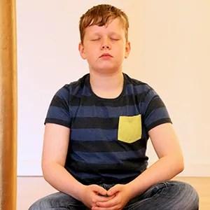 Child meditating during school visit