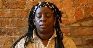 Meditation: woman meditating at Manchester Buddhist Centre