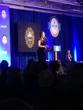 Chelsea Clinton speaking at the Kennedy-Clinton dinner