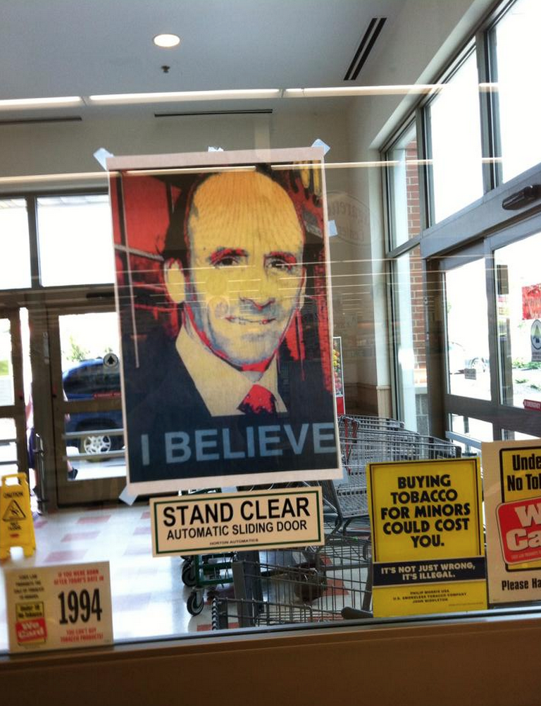 Portraits of Arthur T. DeMoulas are posted inside the Manchester, NH, Market Basket on Elm Street.