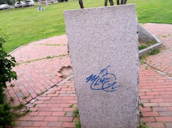 A tag on the granite monument at Derryfield Park.