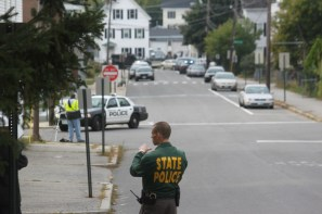 A state police officer rerouting traffic around West High School during lockdown.