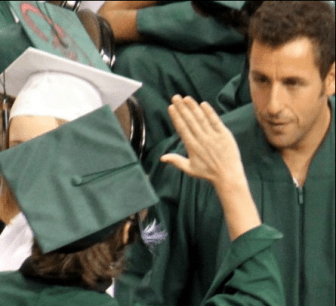 Adam Sandler gets a high-five from Central HS graduate in 2010.