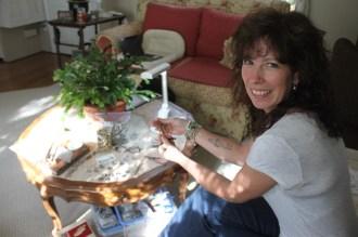 Michelle Erdman working on her bullet jewelry.
