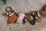 Detail of penny/bullet bracelet.