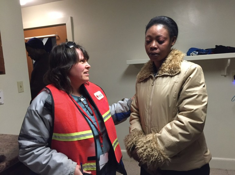 Kim Richards of the Red Cross assisting fire victim Nadia Osman after she was burned out of her apartment.