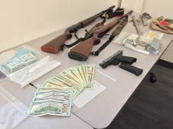 Money, rifles, guns and ammo were confiscated in the sweep.