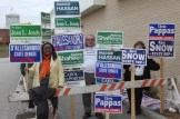Sign holders greeting voters at Ward 3.
