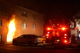 Fire shoots from the first-floor of an apartment building at 65 Log Street on Dec. 21.