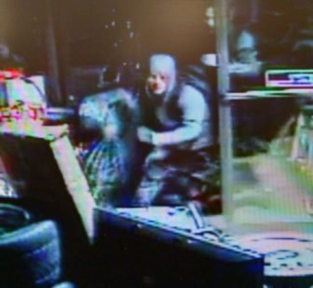 Pawn shop video still of possible burglary suspect.