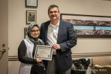 Aya Raouf, West High School student, left, with Chief David Mara. Aya, originally from Iraq, was among the first graduates of YLA , class of 2012.
