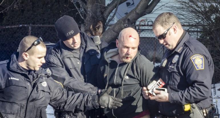 Benjamin Bennett, alleged Rite-Aid robber, taken into custody by Manchester Police.