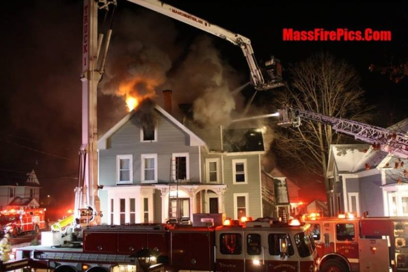 photoManchester Firefighters battle the Jan. 16 Harrison Street fire. Photo credit: Dave Stewart/MassFirePics