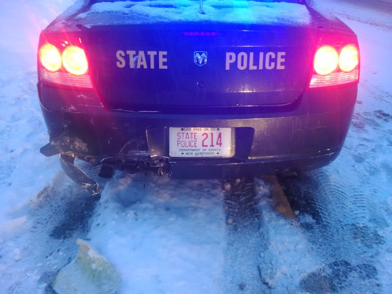 Another view of the damage to the State Police cruiser.