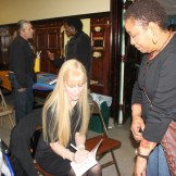 Laurielee Woodlock Roy signs a copy of the book.