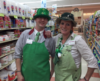 John Gagnon, left, and Suzi Bussiere, wearin' the green at Market Basket.