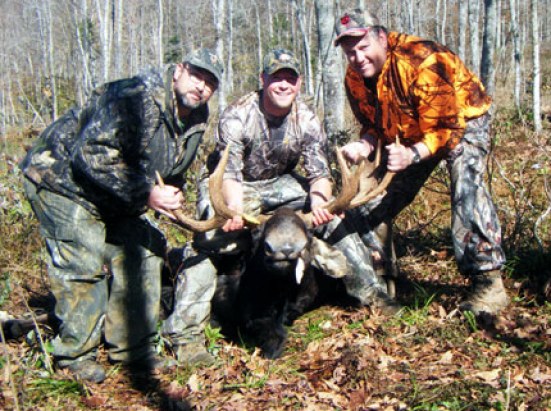 """October 19, 2009, this 650 lb. 3 1/2 year old bull was shot in zone B by Richard Gregoire of Manchester and fellow permittee, """"Ross"""" as identified in this NHFG cutline."""